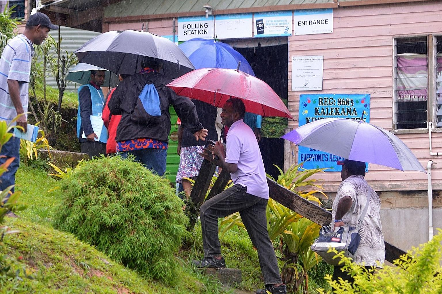 A queue to vote in the general election in Suva yesterday, although heavy rain dampened the turnout in the Fijian nation.