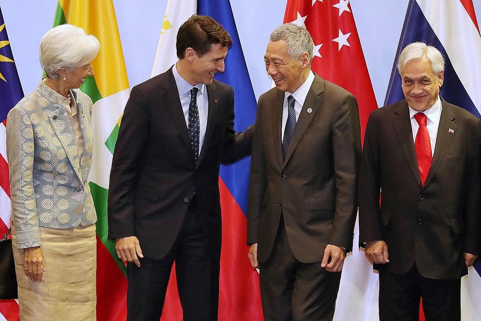 Prime Minister Lee Hsien Loong with (from left) IMF chief Christine Lagarde, Canadian Prime Minister Justin Trudeau and Chilean President Sebastian Pinera before the leaders headed for a working lunch yesterday.