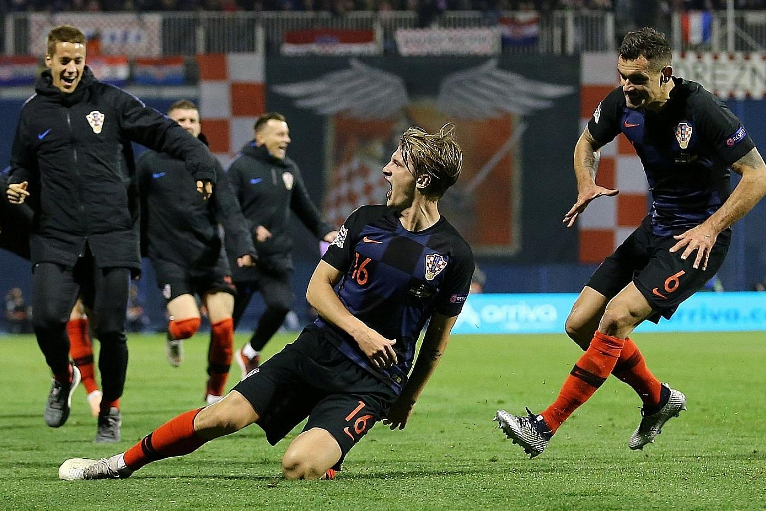 Tin Jedvaj is joined by teammates after scoring the winner in Croatia's 3-2 victory over Spain. Jedvaj's brace was his first international goals.