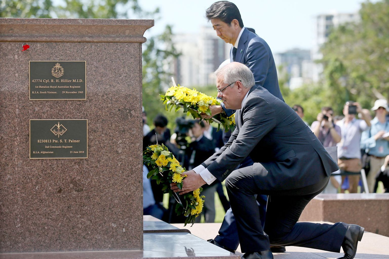 Australian Prime Minister Scott Morrison and visiting Japanese leader Shinzo Abe laying wreaths at the Cenotaph War Memorial in Darwin, Northern Territory, yesterday.