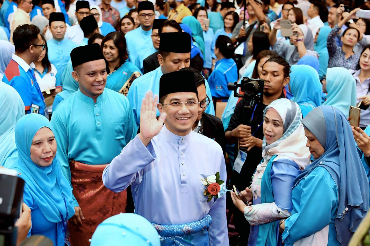 """Mr Azmin Ali (waving) is now poised as a future premier in his own right. One observer said: """"Azmin's people are now in key positions and if Anwar (Ibrahim) does not work with them, they may slow, or add uncertainty, to the latter's ascension."""""""