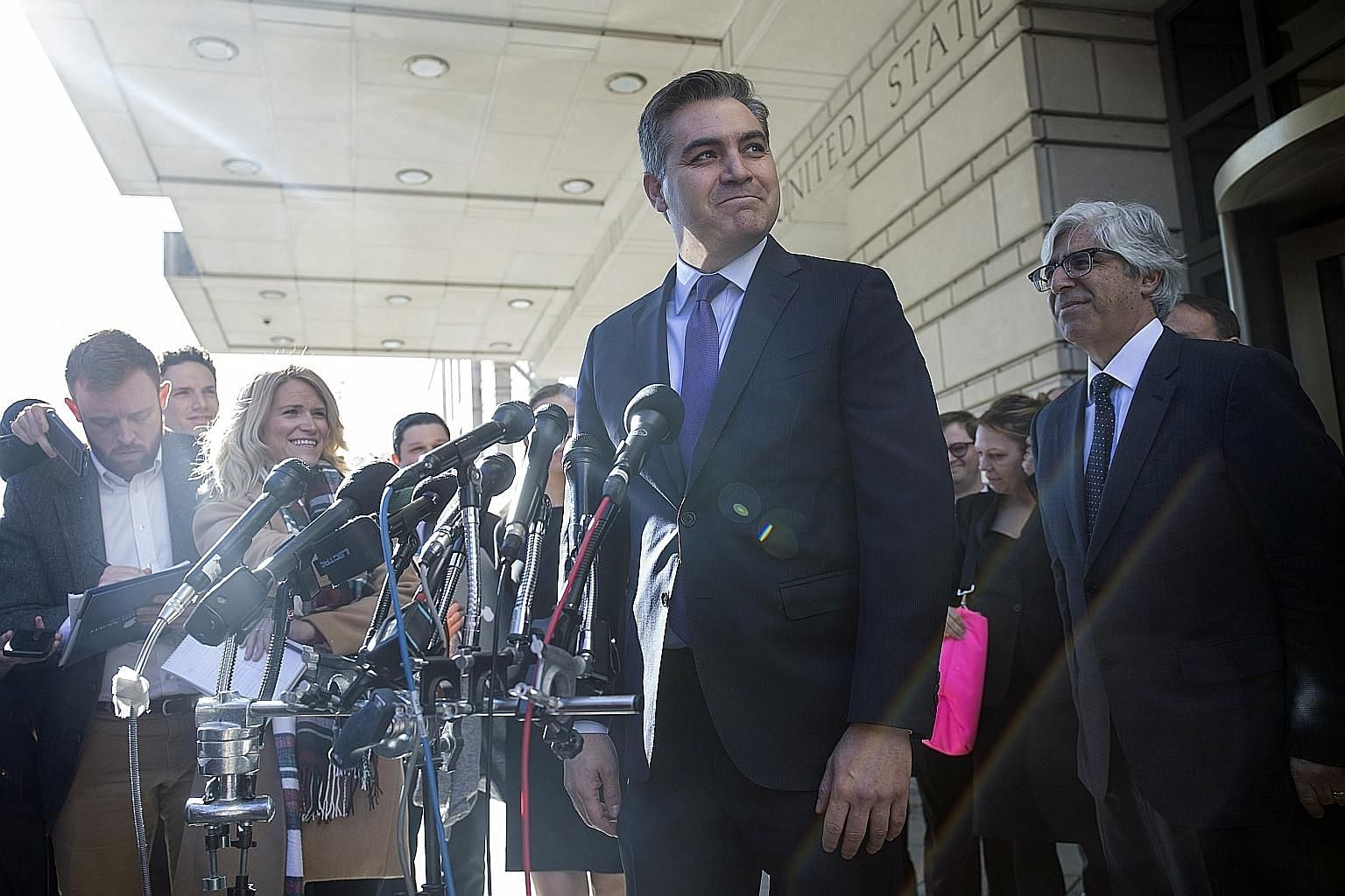 CNN correspondent Jim Acosta speaking to reporters outside the US district courthouse after his press pass was restored.