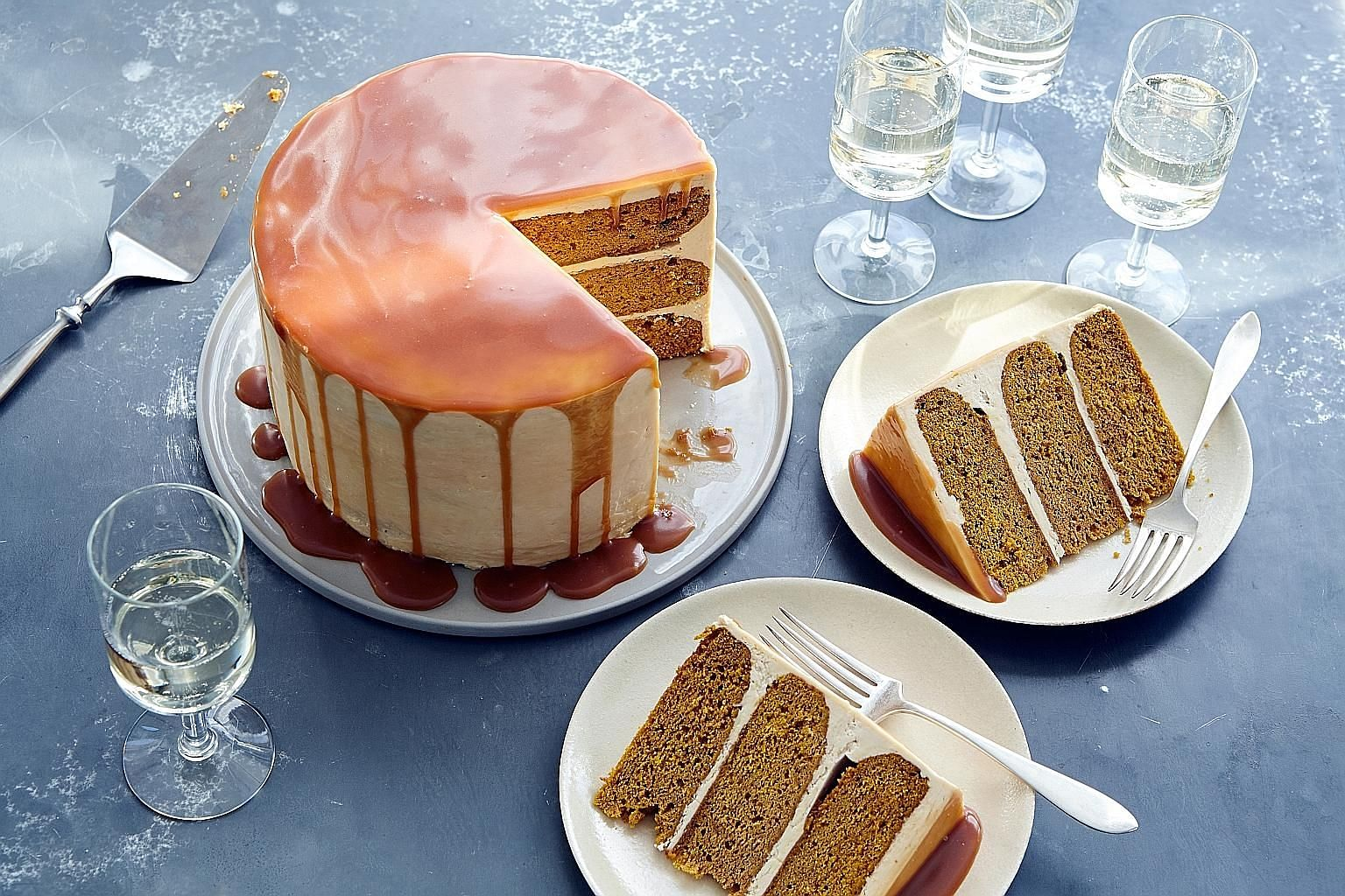Bake layered pumpkin cake drizzled with caramel buttercream for Thanksgiving instead of the staple pumpkin pie.