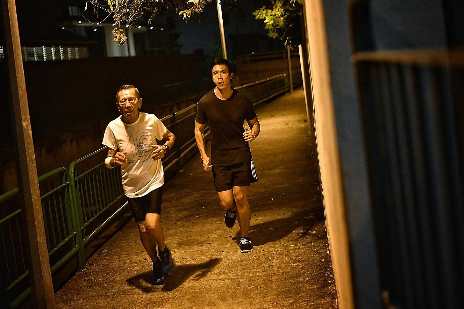 The writer Justin Kor trying to keep pace with his grandfather, Kor Hong Fatt, while training for next month's Standard Chartered Singapore Marathon.