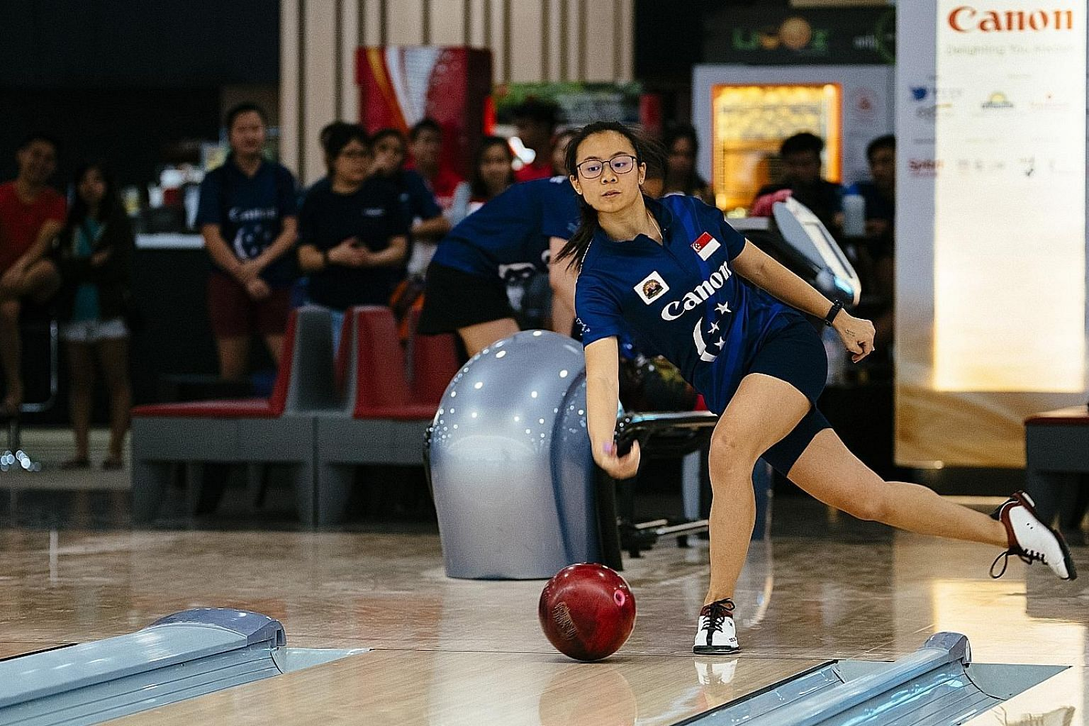 Charlene Lim, 19, cruised to a 203-155 pinfall victory over Geraldine Ng to clinch the women's title in the 49th Singapore National Championships yesterday at the SingaporeBowling @ Rifle Range bowling centre. Fellow teenager Jomond Chia, 18, was the
