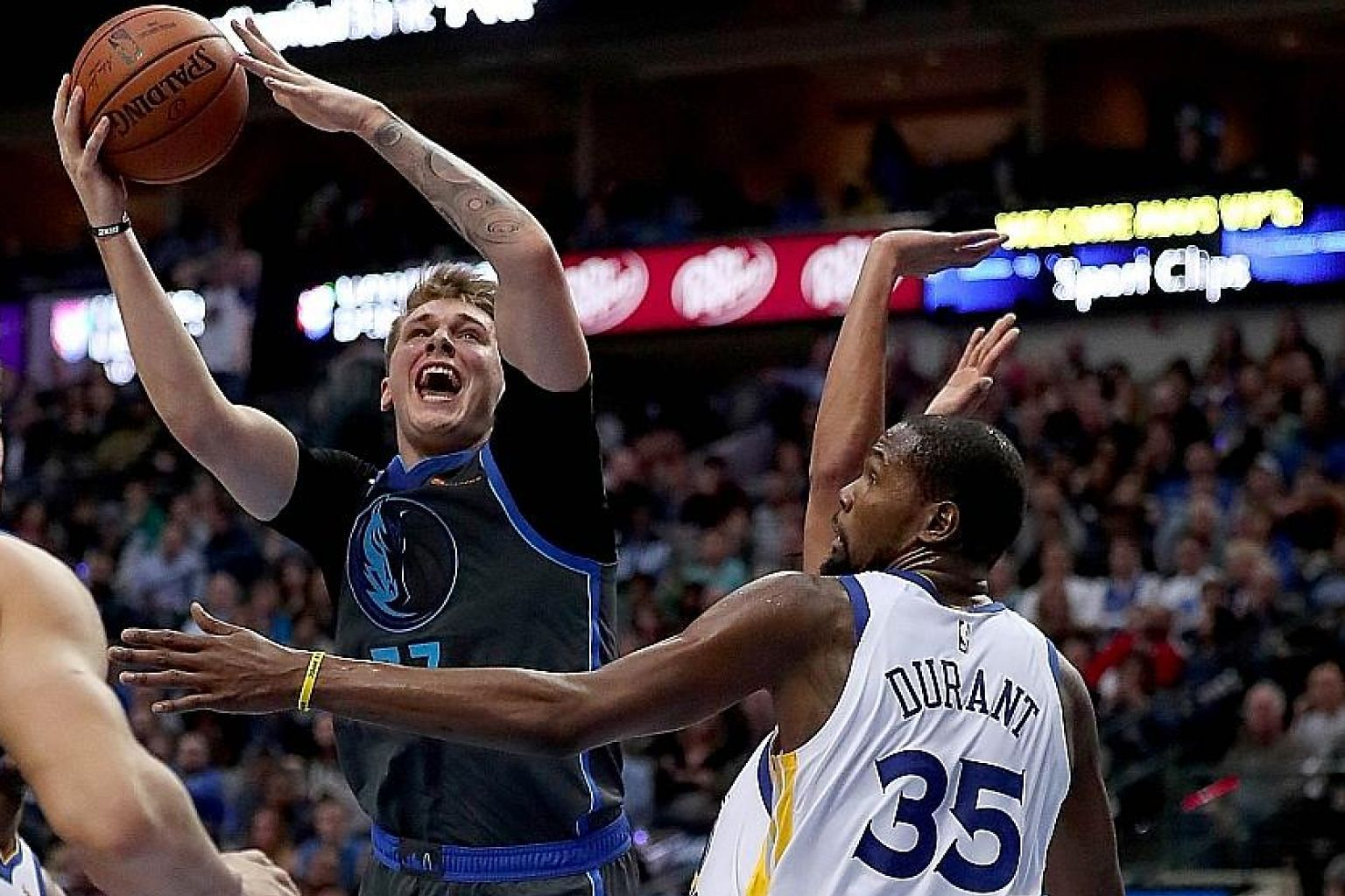 Dallas Mavericks' Luka Doncic driving to the basket against Golden State Warriors' Kevin Durant at the American Airlines Centre in Texas on Saturday. The Warriors lost a second straight game for the first time this season.