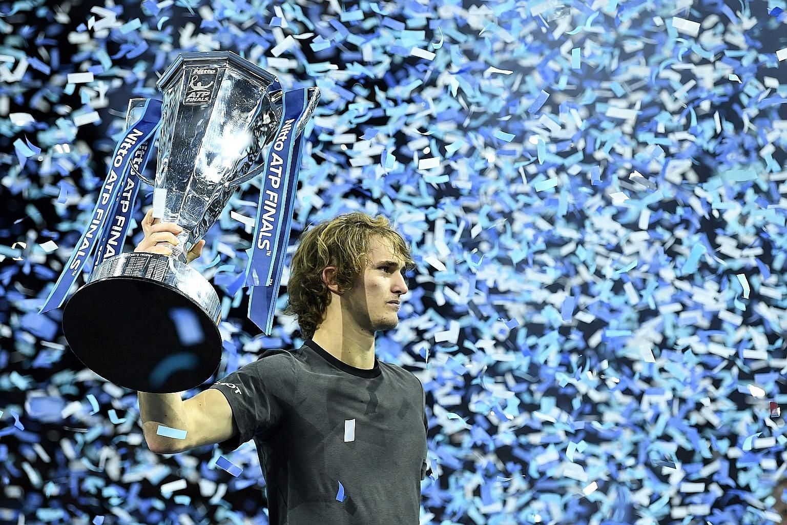 Alexander Zverev beat world No. 1 Novak Djokovic in straight sets in London on Sunday to win his first ATP Finals title.