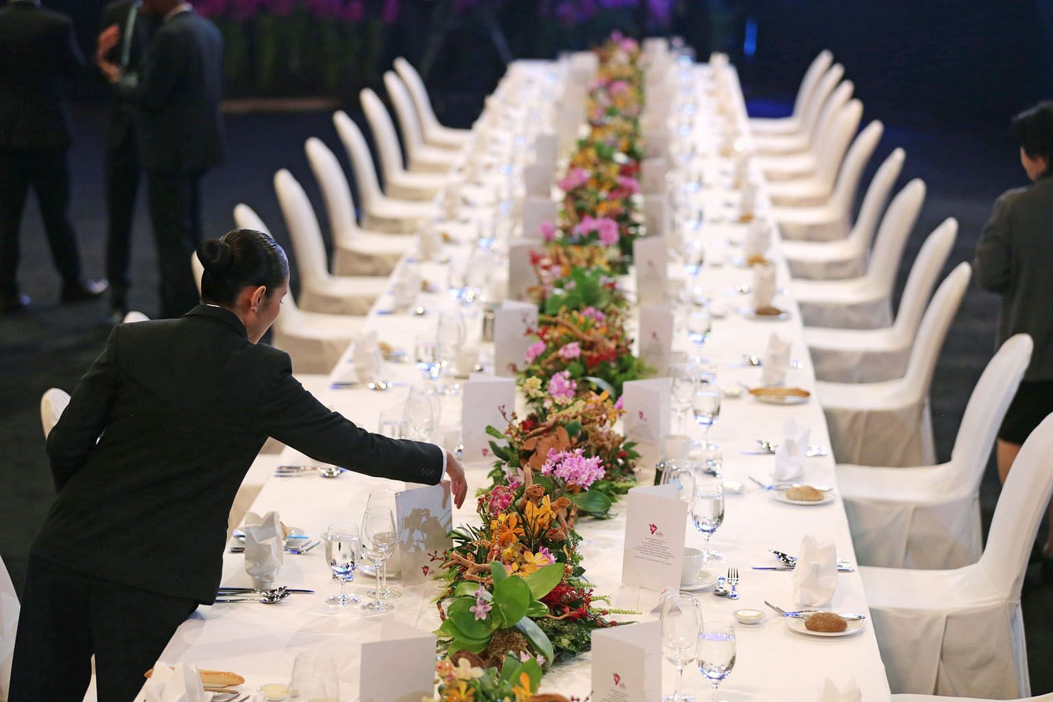 A member of the banquet staff preparing the table for the gala dinner at this year's Asean Summit. During its chairmanship, Singapore spearheaded the Asean Smart Cities Network, which connects cities with private-sector partners to co-develop solutio