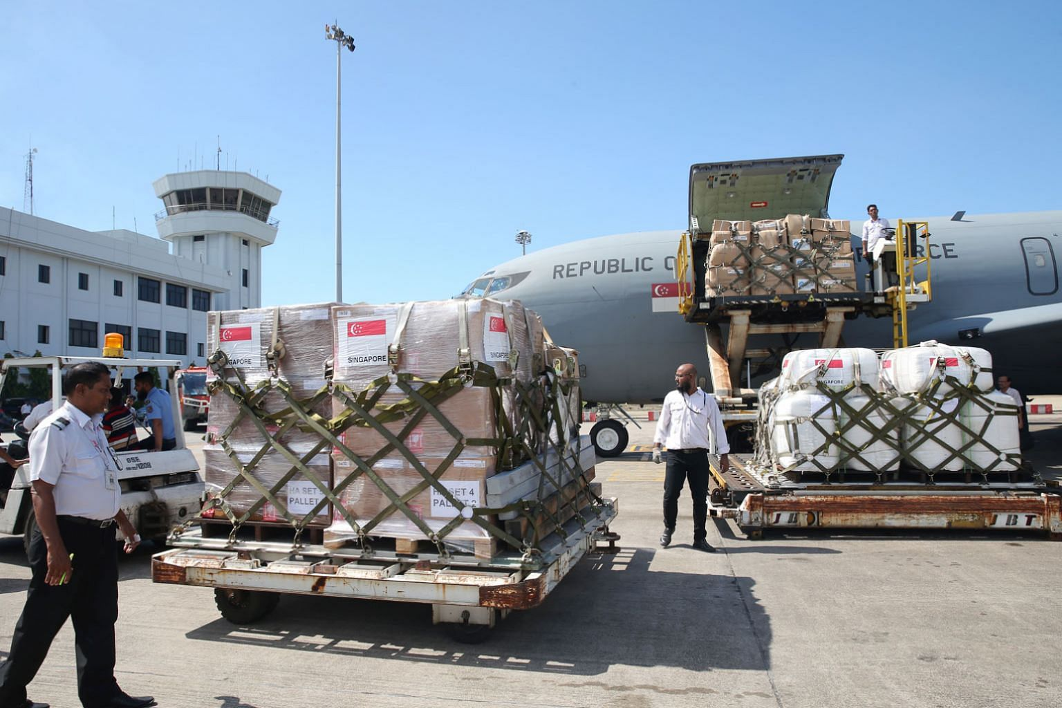 Supplies from Singapore being unloaded at the airport in Bangladesh in October last year.