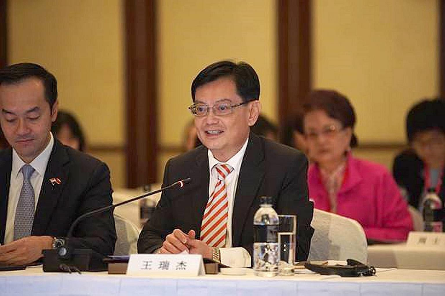 Finance Minister Heng Swee Keat (at right) said Singapore is committed to partner Jiangsu in supporting China's economic priorities. With him is Senior Minister of State for Trade and Industry Koh Poh Koon.