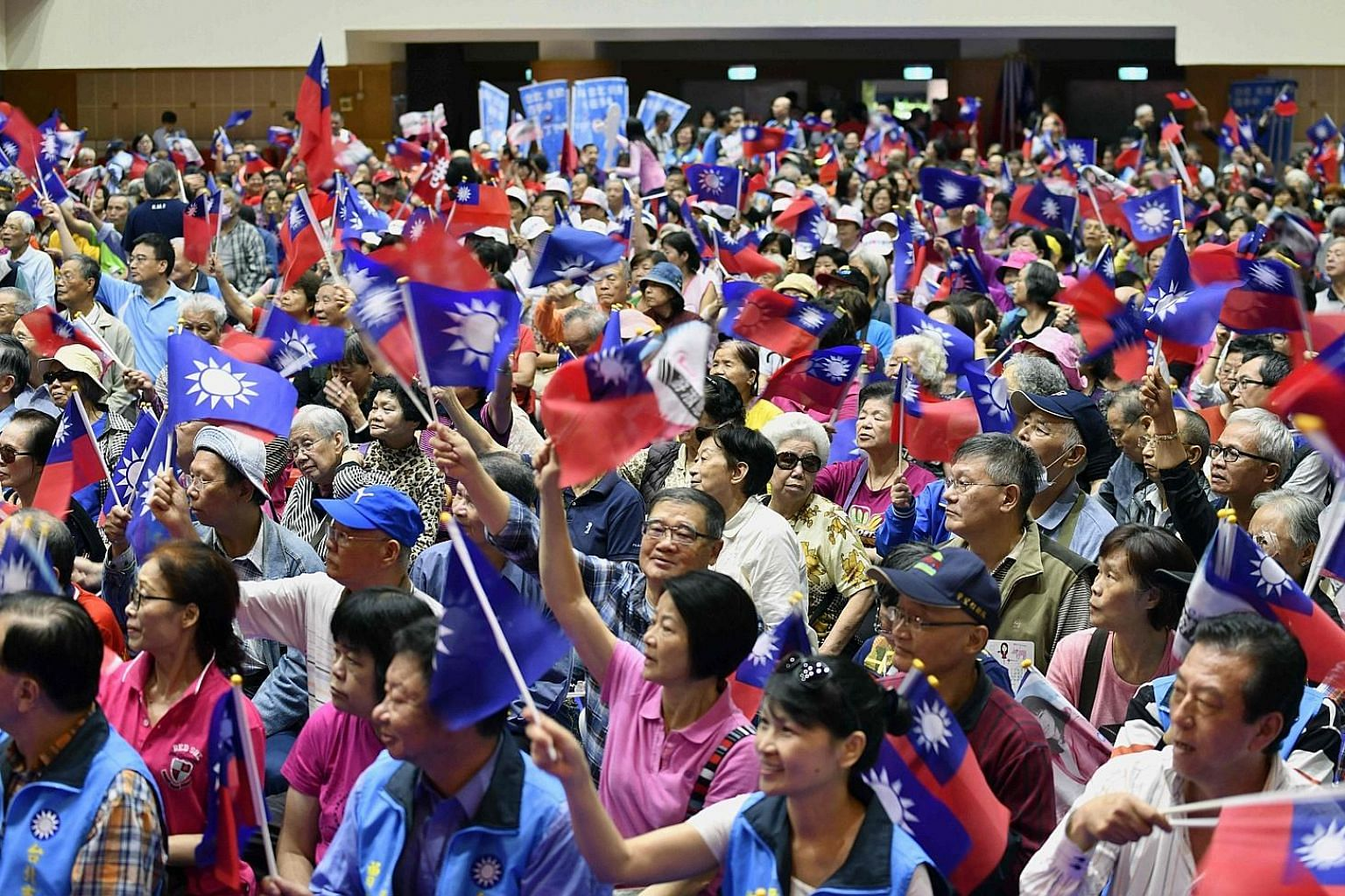 Supporters at a rally for Taiwan's main opposition party Kuomintang in Taipei on Nov 10. The results of Saturday's municipal polls will be seen as a midterm test of confidence in President Tsai Ing-wen's rule, and a loss for her Democratic Progressiv