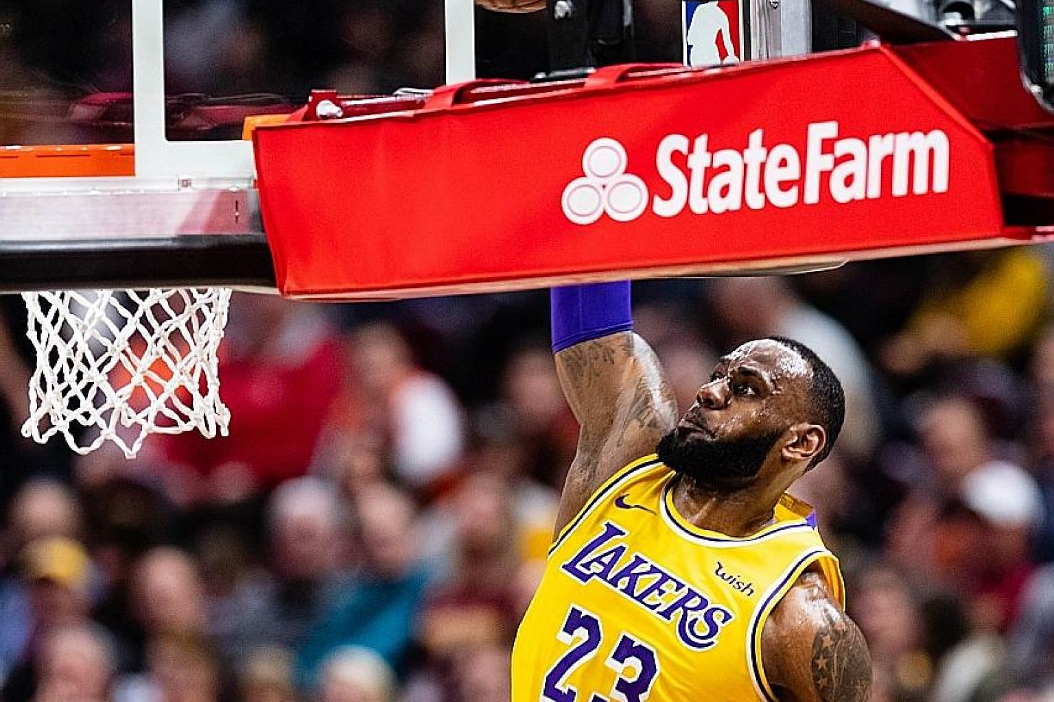 LeBron James dunking the ball as the Cleveland Cavaliers' Tristan Thompson is powerless to stop him at Quicken Loans Arena in Cleveland, Ohio on Wednesday. The LA Lakers recovered from a nine-point deficit with seven minutes left to win 109-105.