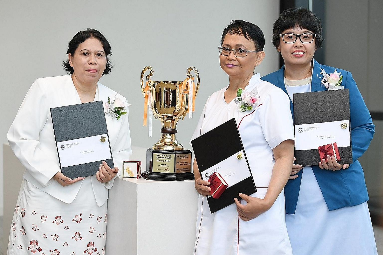 (From left) Tan Chin Tuan Nursing Award first-prize winner Rahinah Ibrahim of the Institute of Mental Health, second-prize winner Faridah Hassan of Ng Teng Fong General Hospital and third-prize winner Jenny Yong of the Home Nursing Foundation. Seven