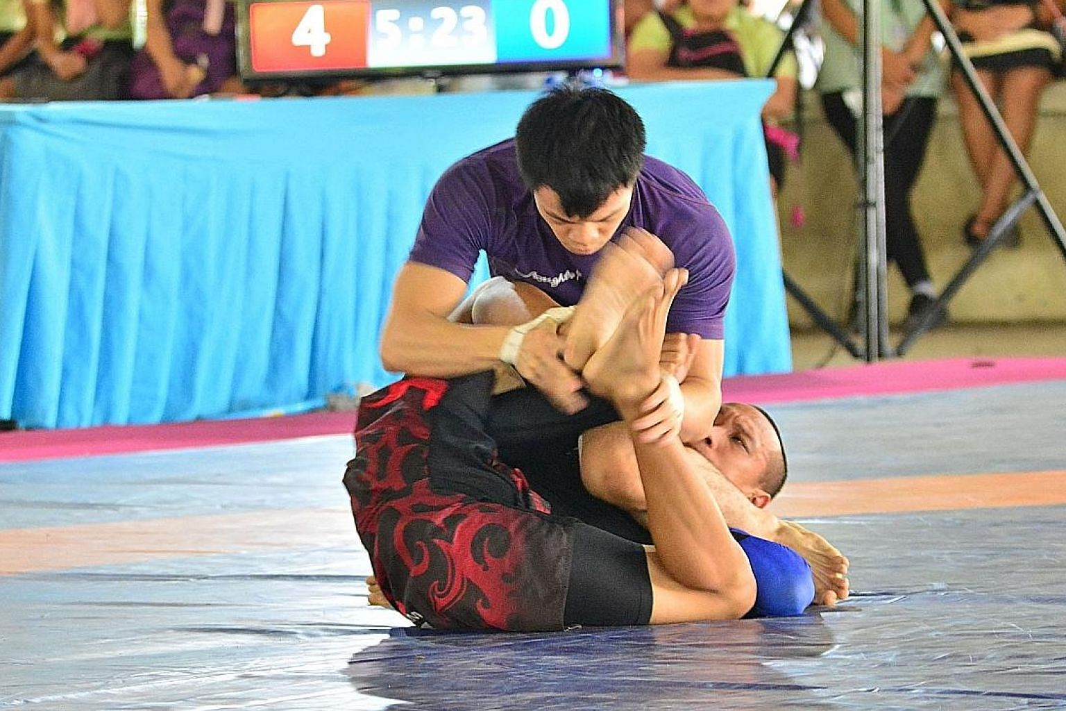 Garie Tang well in control on his way to a gold medal in the no-gi grappling 58kg class at the South-east Asian Wrestling and Grappling Championship in the Philippines.
