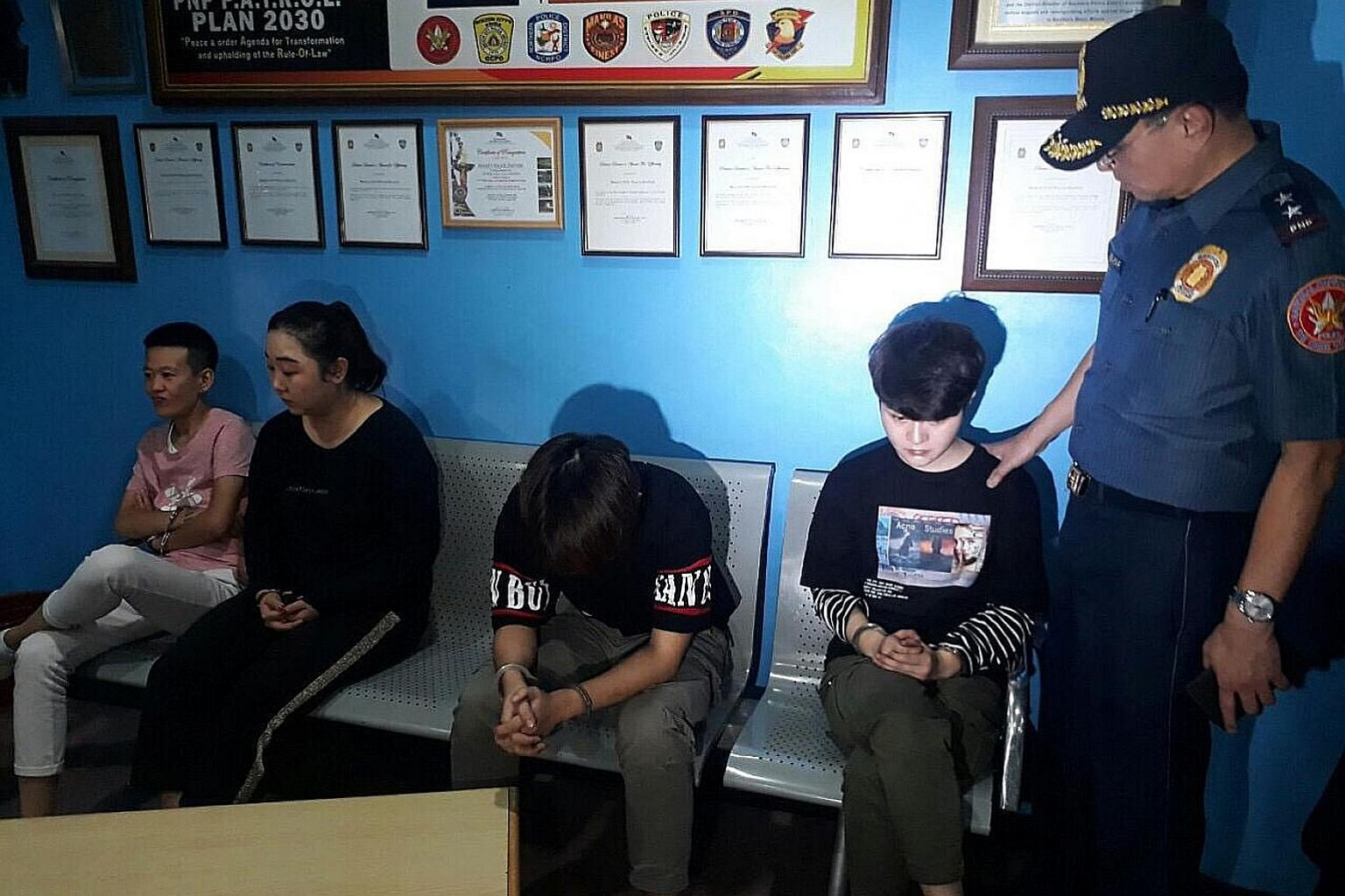 The four suspects (clockwise from top left) Zhang Chuquan, Zhang Chuning, Wang Xue and Zhang Xixi, and in custody at a police station in Makati (left).