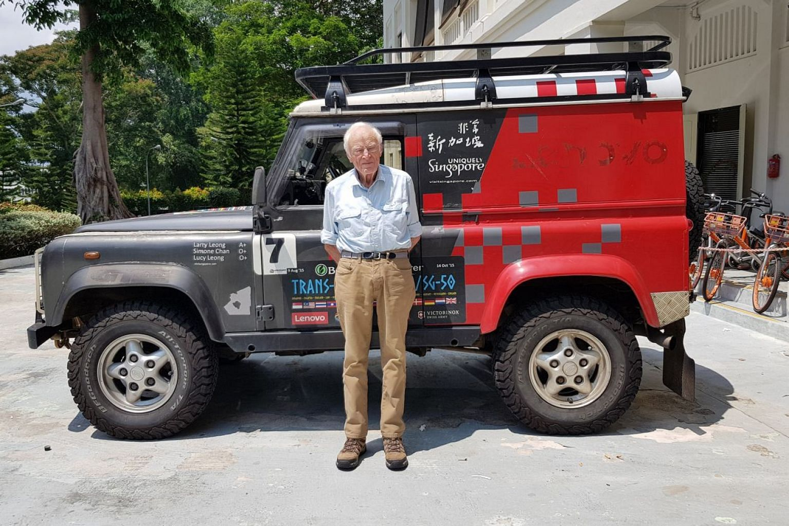 Mr Tim Slessor plans to drive from Singapore to London next year. Next to him is a Land Rover Defender owned by Mr Larry Leong, who drove it from London to Kuala Lumpur in 2007 and from Singapore to London in 2015.