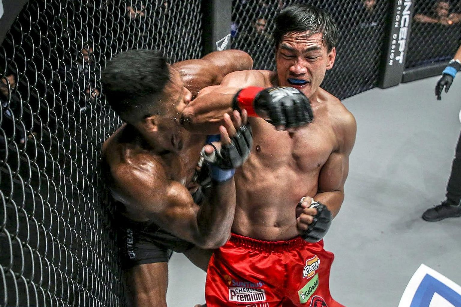 Singapore's Amir Khan is caught by a sharp elbow from Filipino Eduard Folayang, whose vast experience saw him triumph in the One Championship lightweight (up to 77kg) world title match at the Conquest of Champions event in Manila on Friday night.