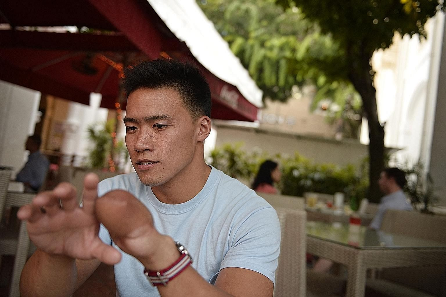 Mr Ang Jun Heng lost four fingers during a vicious attack by a gang of four robbers in 2010, but he bears them no grudges - and has gone on to represent Singapore in the 2011 Paracanoe World Championships.