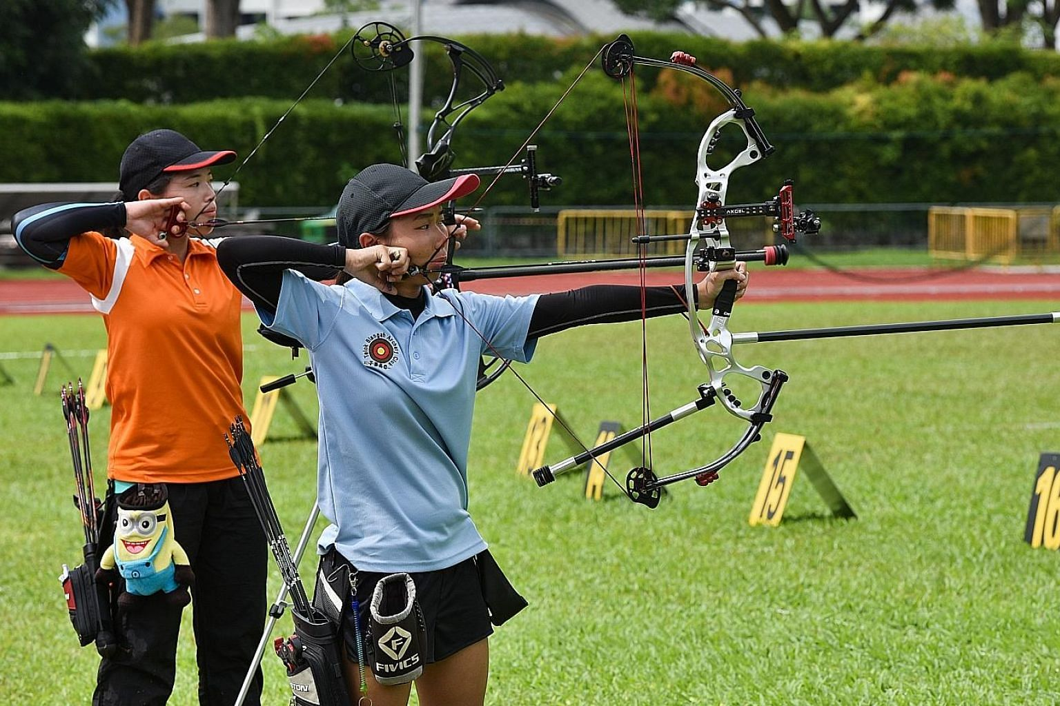 Contessa Loh (in orange) of the Flaming Arrows Archery Club and Ang Hwee Ying, 23, of Telok Blangah Archery Club facing off in the final of the Compound Women's category.