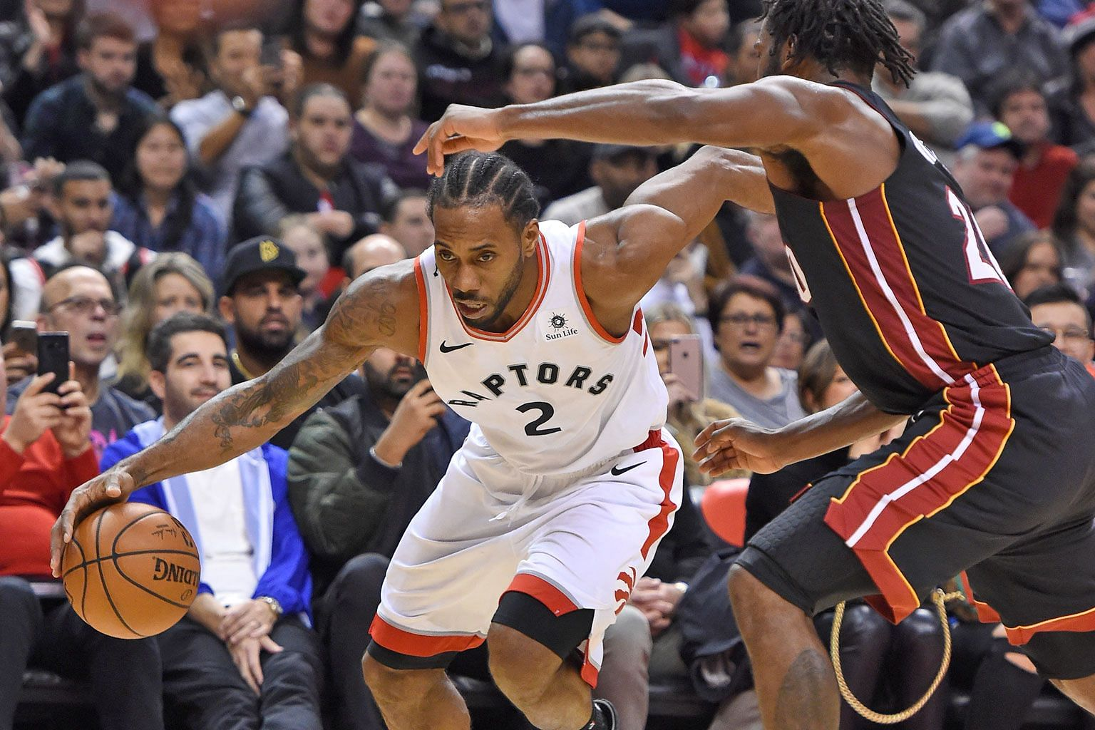 "Toronto forward Kawhi Leonard dribbling past Miami forward Justise Winslow during the Raptors' 125-115 win at Scotiabank Arena on Sunday. He says he found his former San Antonio coach Gregg Popovich's comments that ""he wasn't a leader"" funny."