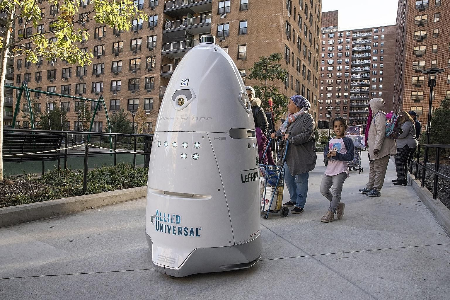 Rosie the robot ambles through the grounds of LeFrak City, a housing complex in Queens, New York, acting as an extra set of eyes for the security team.