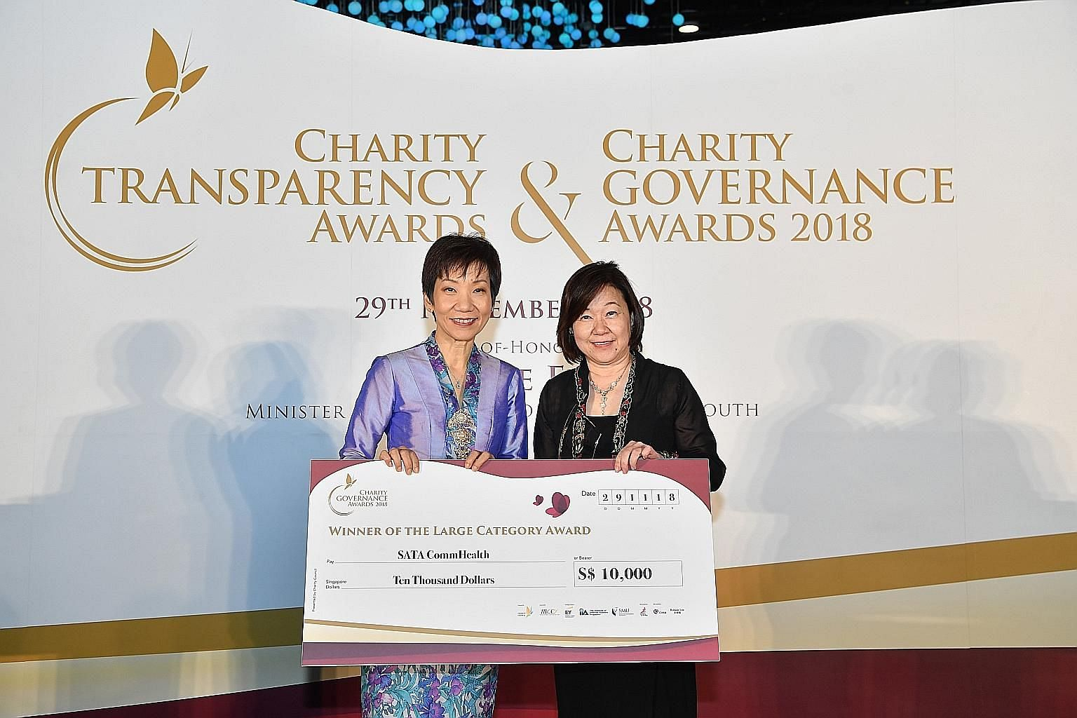 Minister for Culture, Community and Youth Grace Fu (far left) presenting the Charity Governance Award for charities in the large category to Ms Theresa Goh, chairman of Sata CommHealth, at yesterday's award ceremony.