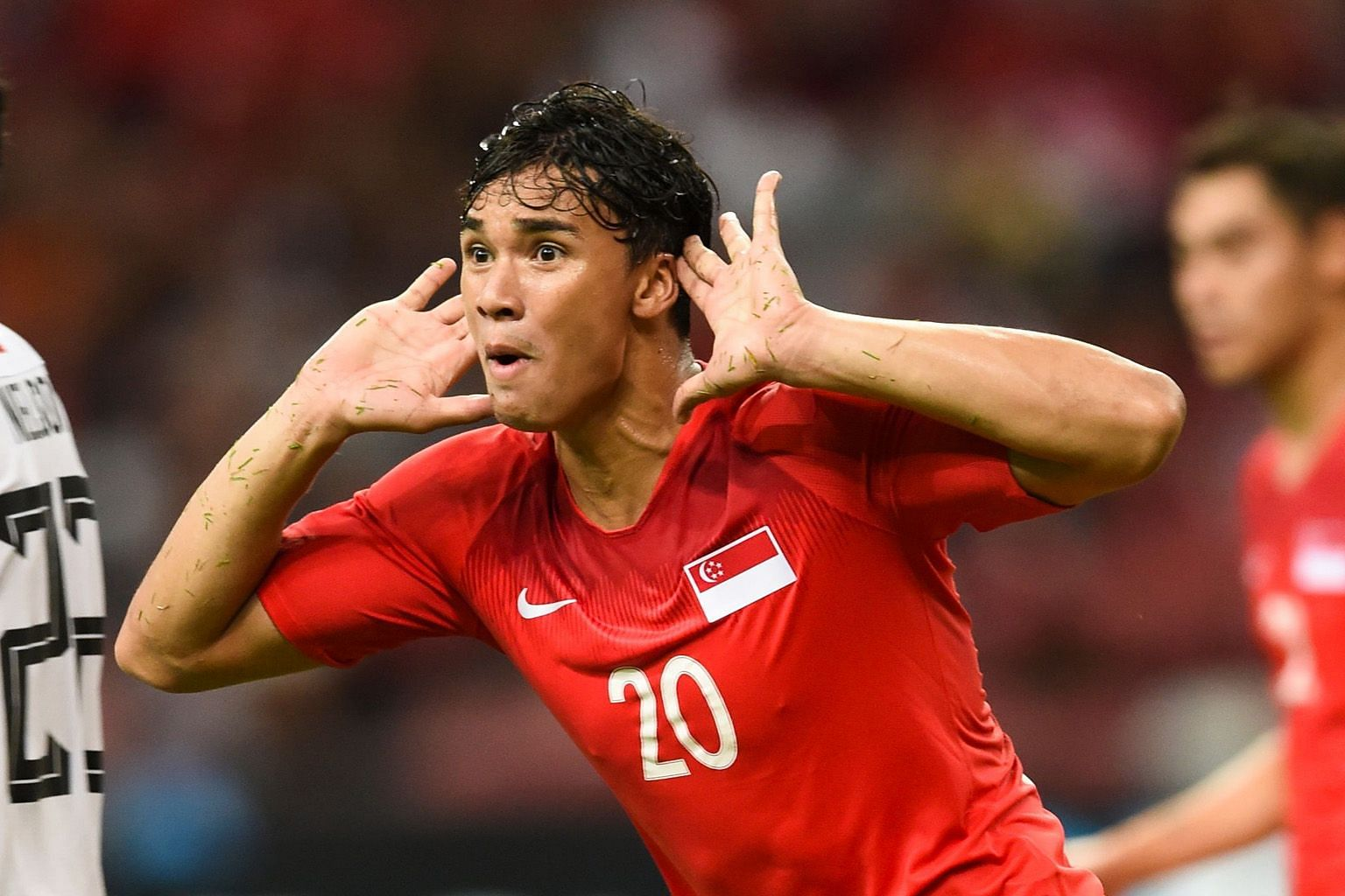 Ikhsan Fandi celebrating a highlight-reel goal, a bicycle kick to put Singapore 4-1 up against Timor-Leste on Nov 21. The Lions won 6-1 in the AFF Suzuki Cup group game at the National Stadium but eventually failed to make the semi-finals.