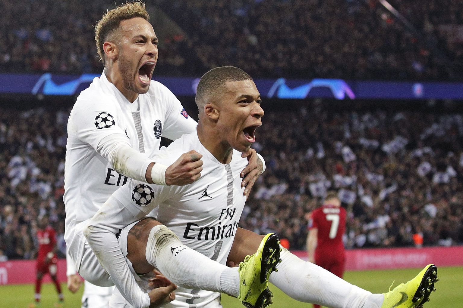 Paris Saint-Germain's Neymar (left) celebrating with Kylian Mbappe after scoring in their 2-1 win over Liverpool. The Brazilian repeatedly went down at the slightest of contacts to break up the game's flow.
