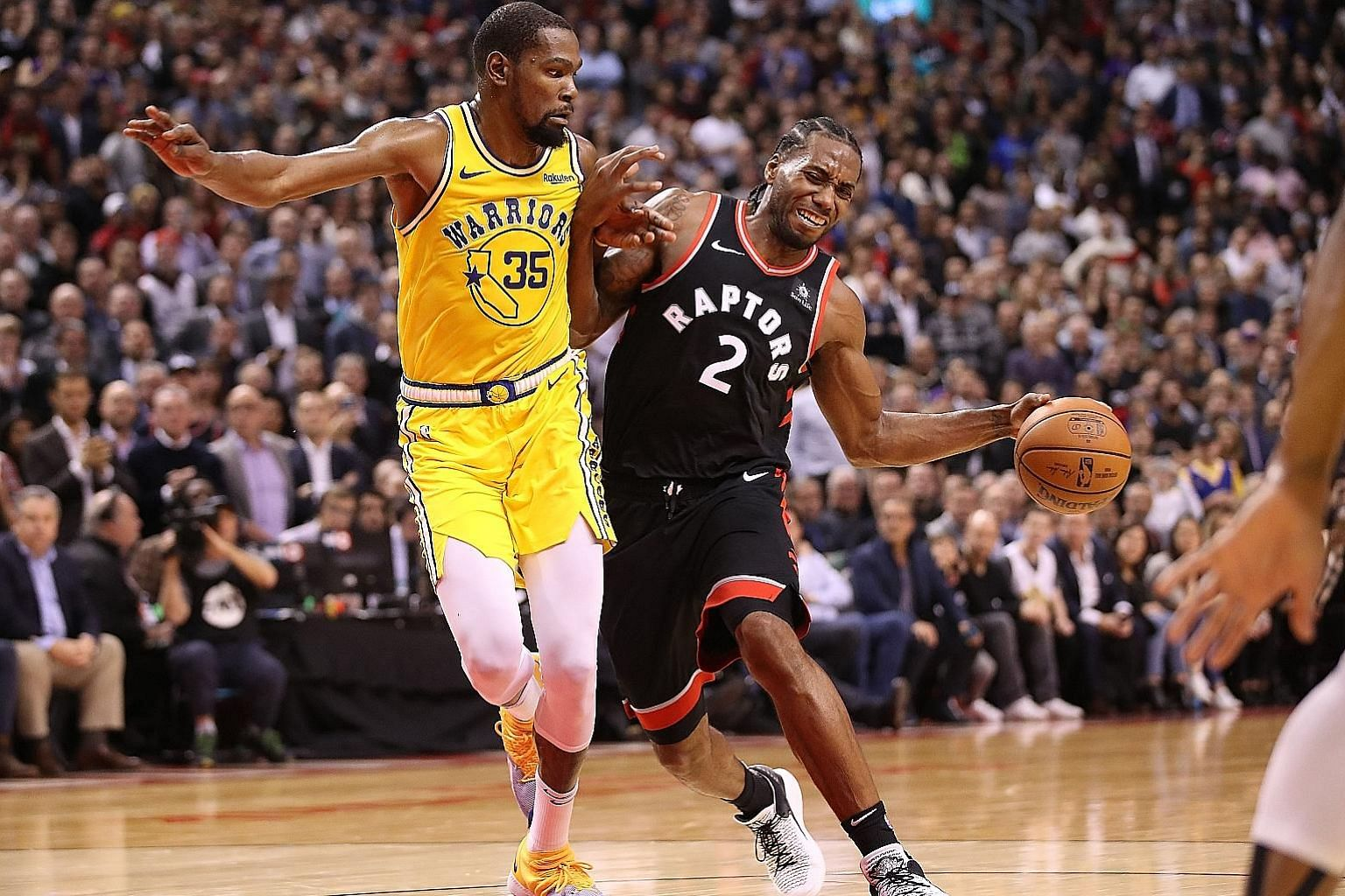 In a battle of the two teams' top scorers, a monster 51-point effort by Golden State's Kevin Durant was not enough, with Raptors forward Kawhi Leonard contributing 37 points in Toronto's 131-128 overtime win over the Warriors on Thursday.