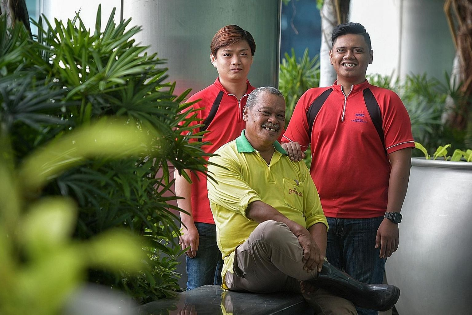 Landscape technician Md Yasin Ithnin (centre) from Prince's Landscape and Construction has seen his basic pay rise from $1,300 to $1,550 now. With him are Mr Jarren Teo, assistant landscape supervisor, and Mr Muhammad Ridduan Sarman, landscape techni