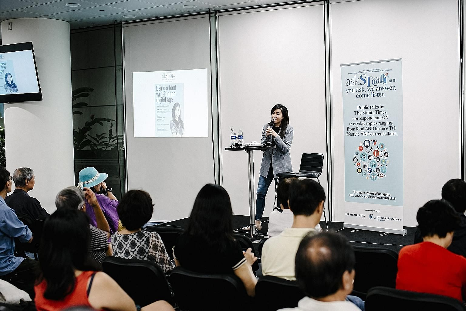 Straits Times food writer Rebecca Lynne Tan sharing her experiences with the audience during her talk at the Central Public Library on Friday.