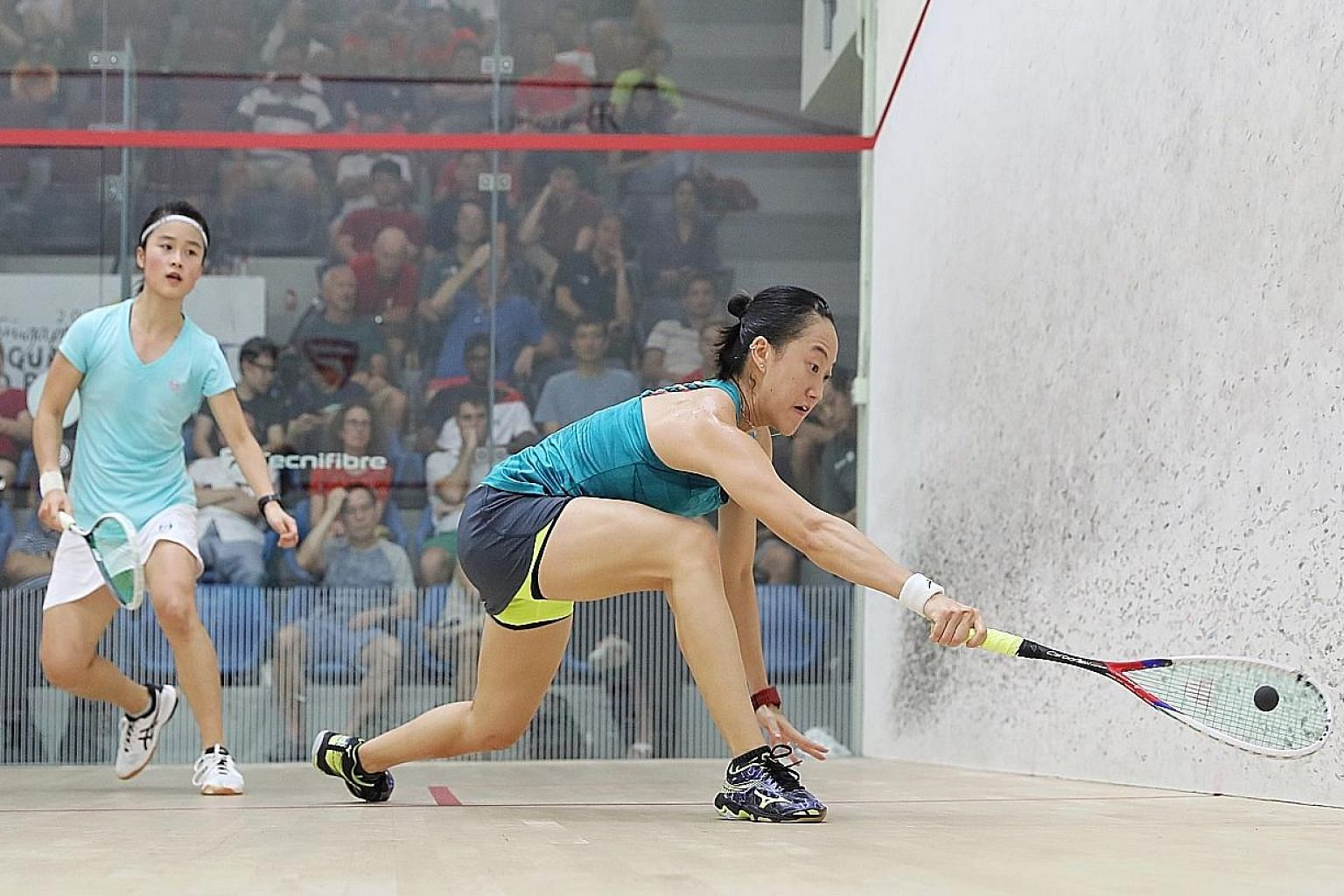 Low Wee Wern (right) returning a shot against Lee Ka Yi in the Singapore Squash Open women's final yesterday. The former world No. 5 won 11-6, 11-5, 11-3 at the Kallang Squash Centre.