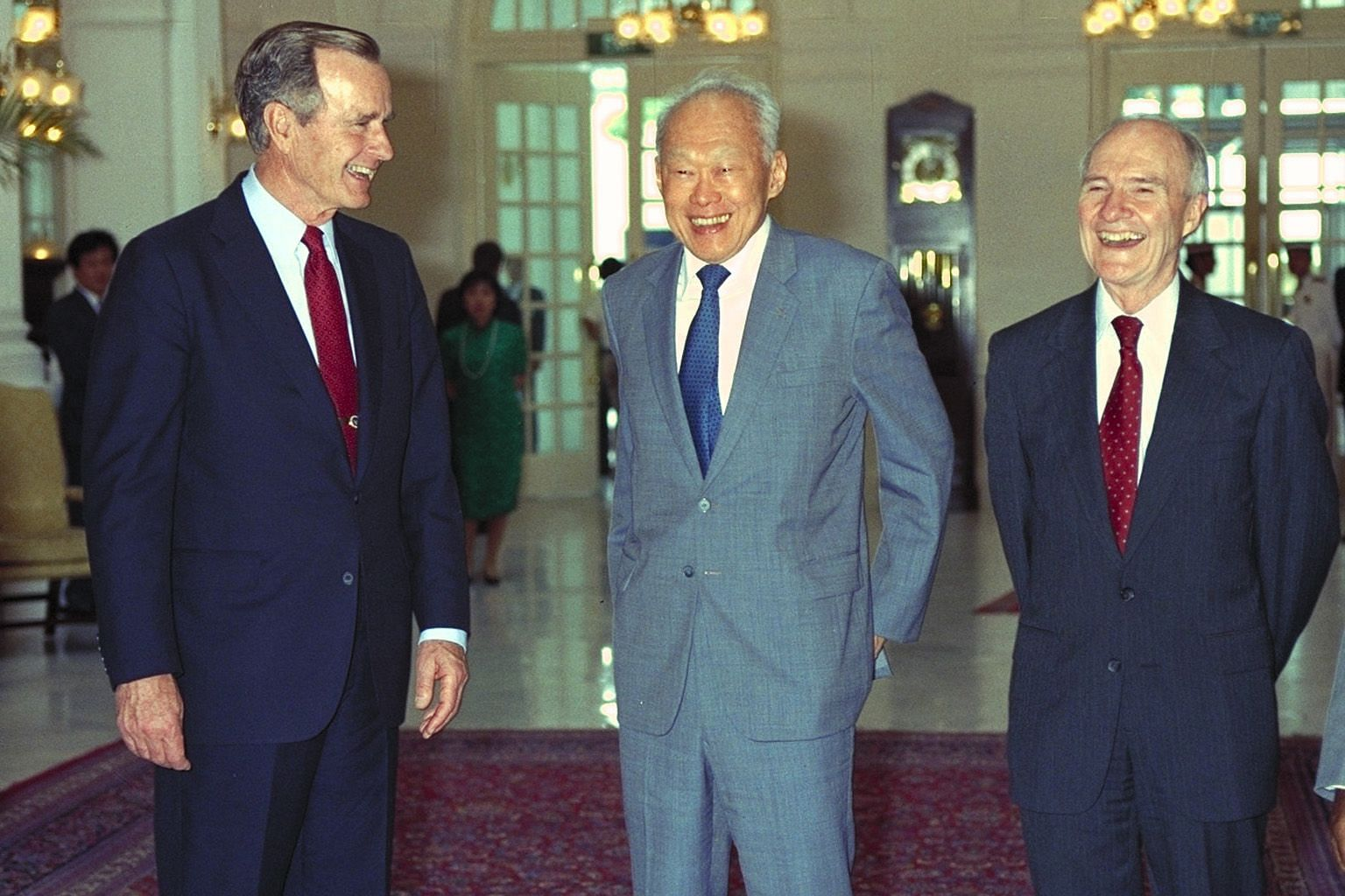 Mr Bush meeting then Prime Minister Goh Chok Tong in June 1998 at the Raffles Hotel. He was in Singapore for a stopover with his wife Barbara and Mr Goh, accompanied by Mrs Goh, visited them at the hotel. Mr Bush had offered to shake hands with Mr Go