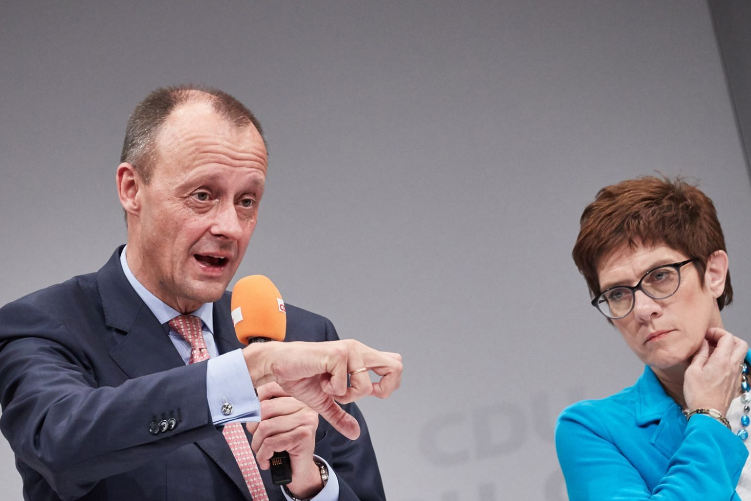Mr Friedrich Merz and Ms Annegret Kramp-Karrenbauer are among contenders to succeed German Chancellor Angela Merkel as leader of the Christian Democratic Union. Mr Merz has questioned if an individual's right to seek asylum in Germany still fits with