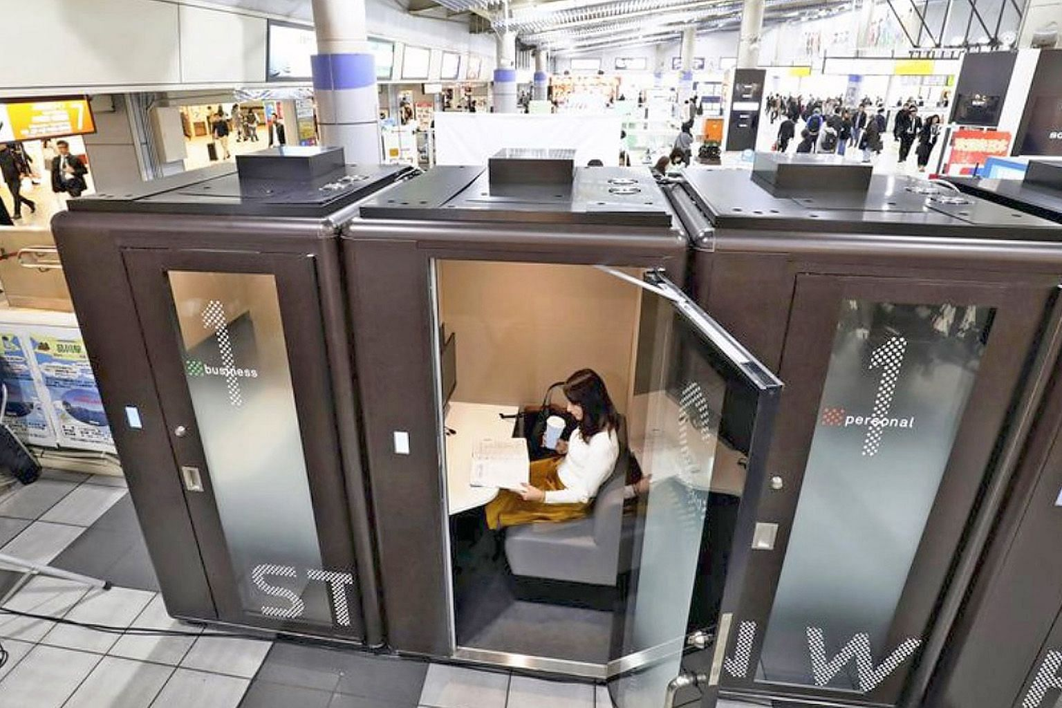 JR East's newly installed individual-use offices inside JR Shinagawa Station. Reservations are made via a designated website and users are allowed to stay in the space for up to 30 minutes. Each soundproofed booth is equipped with a desk, sofa, power
