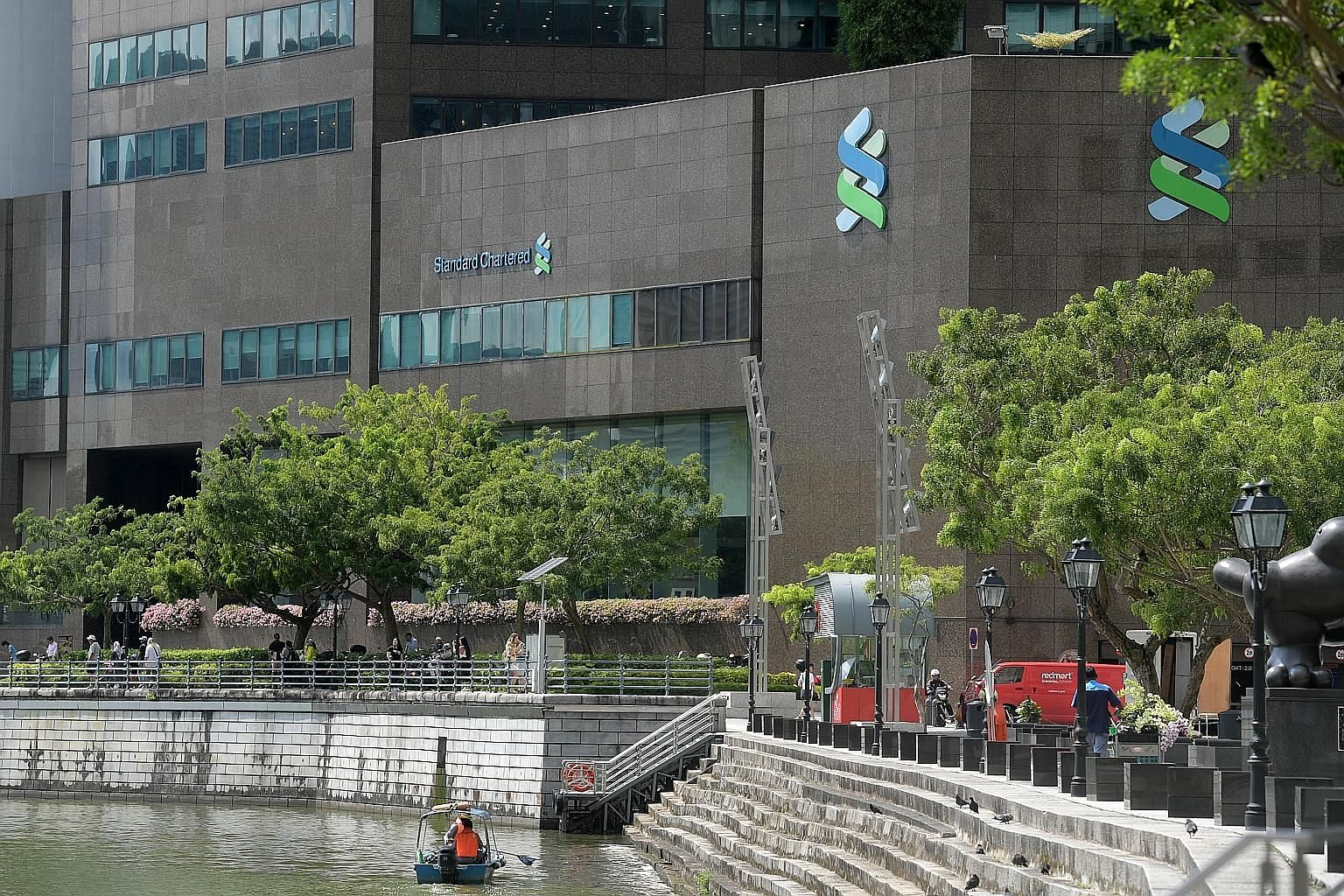 Standard Chartered's job cuts are expected to include Singapore staff, according to people familiar with the matter. Bloomberg News had reported last week that the bank is pressing ahead to create two Asian hubs - one based in Singapore and another i