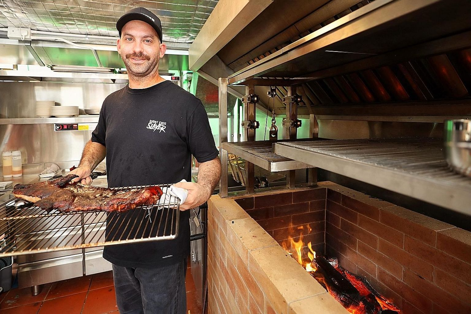 Chef David Pynt's Meatsmith Western BBQ will serve barbecue dishes, including smoked suckling pig, cooked in a brick grill fired with jarrah, an Australian hardwood.