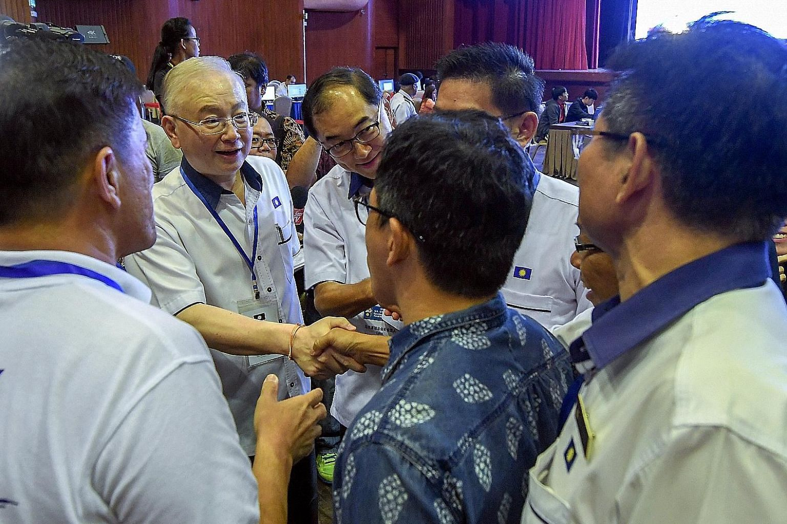 Malaysian Chinese Association president Wee Ka Siong shaking hands with party supporters after the annual assembly on Sunday. Next to him is his deputy Mah Hang Soon. Datuk Seri Wee has called for Barisan Nasional, the former ruling coalition of whic
