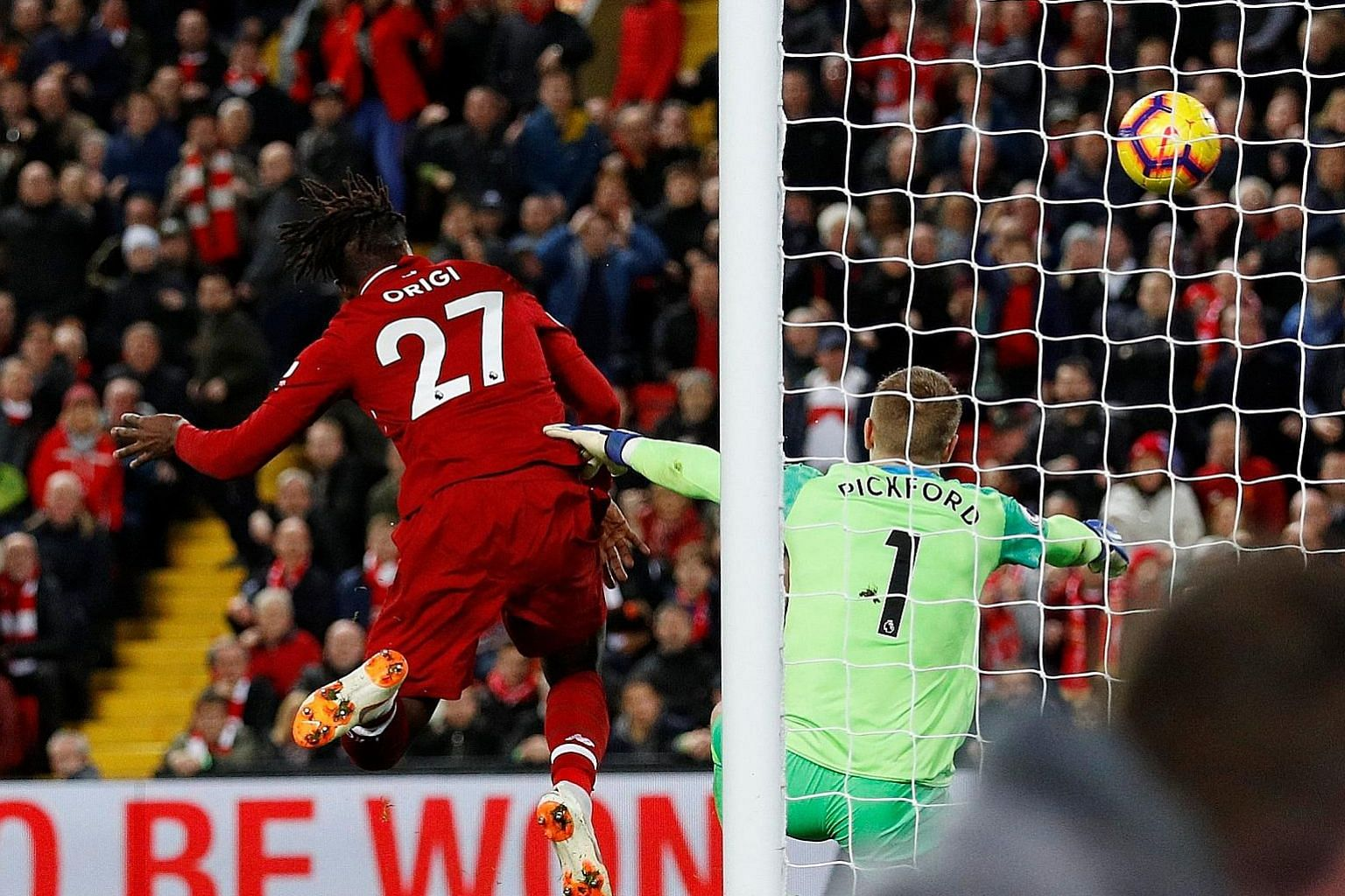 Forward Divock Origi scoring the winner in Liverpool's 1-0 derby victory over Everton at Anfield on Sunday. The bizarre strike prompted Reds manager Jurgen Klopp to run onto the pitch in unbridled celebration.