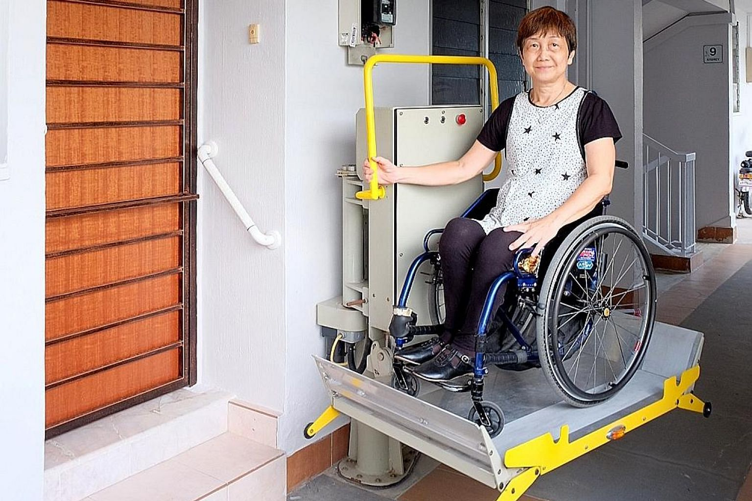 Retired administrative assistant Florence Tan was one of the first few to get a mechanical wheelchair lifter, as part of a test bed in 2015. It has made getting in and out of her flat, which has steps at the entrance, much easier.