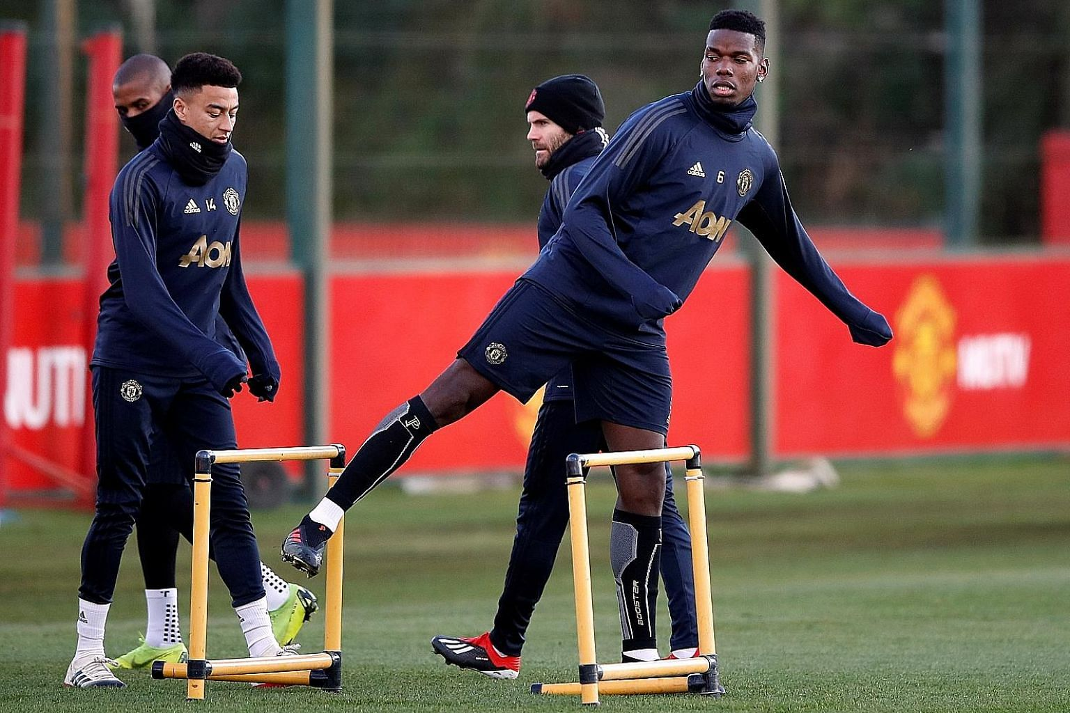 United's Paul Pogba, with Jesse Lingard (far left) and Juan Mata in training. Manager Jose Mourinho has not held back in his criticism of his underachieving players in recent weeks.