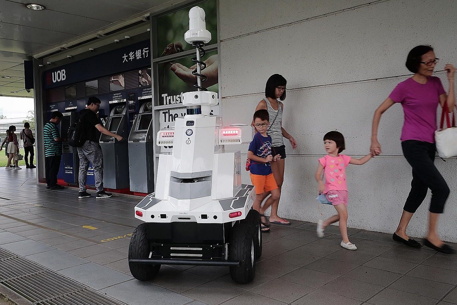 The robot deployed by LTA during Exercise Station Guard at Hougang MRT station yesterday. Developed by ST Engineering, it is equipped with seven cameras to give it a 360-degree view, and has GPS and other sensors. The robot's control console was loca