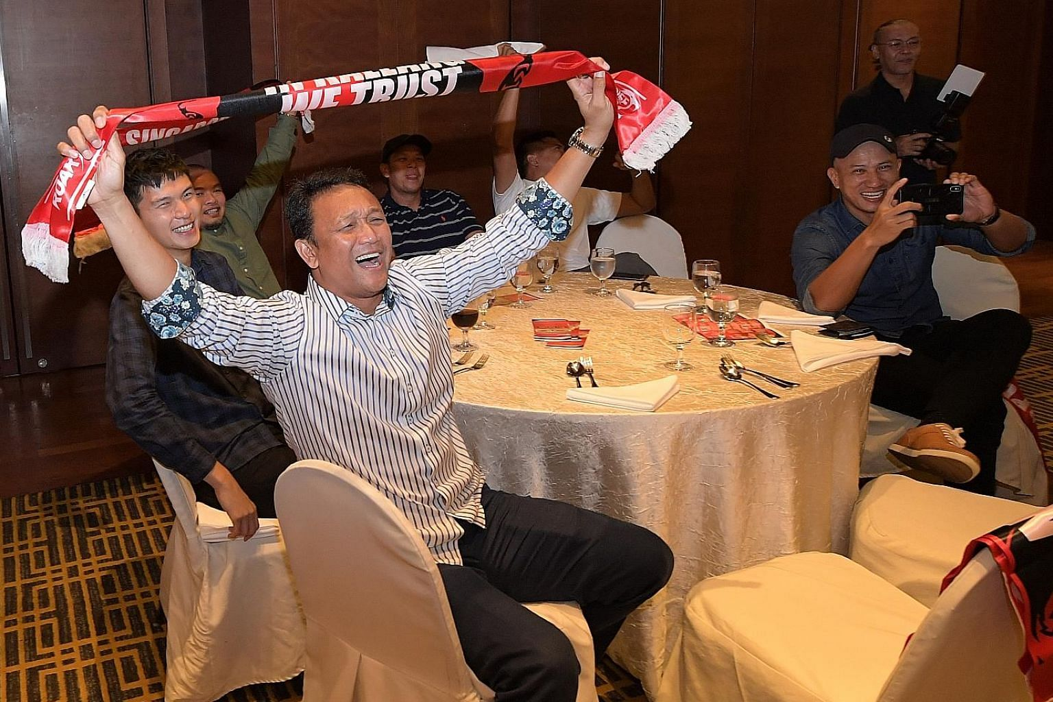 Fandi Ahmad in good spirits at last night's FAS AFF Cup appreciation dinner for stakeholders at Copthorne King's Hotel. He will return to his role as the FAS' head of youth, where he will lead the Under-23s at next year's SEA Games in the Philippines