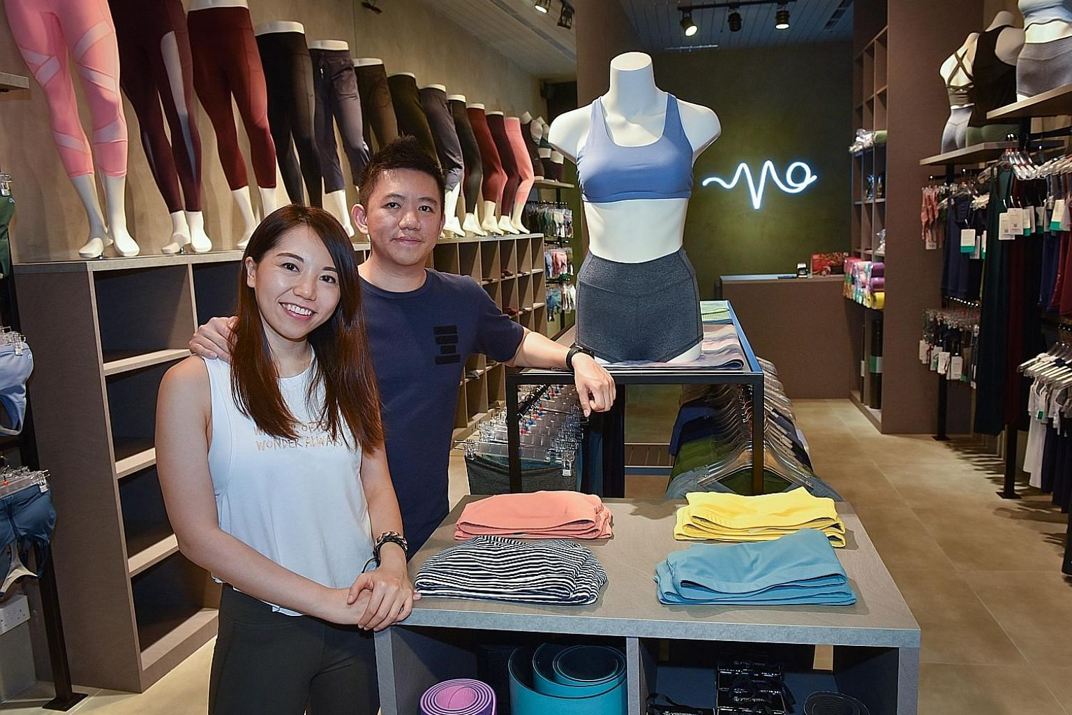 Founded in 2014 by Ms Sylvia Lim and Mr Kevin Chia (both left), mid-range label Vivre Activewear stocks athleisure wear at three retail stores in Singapore.