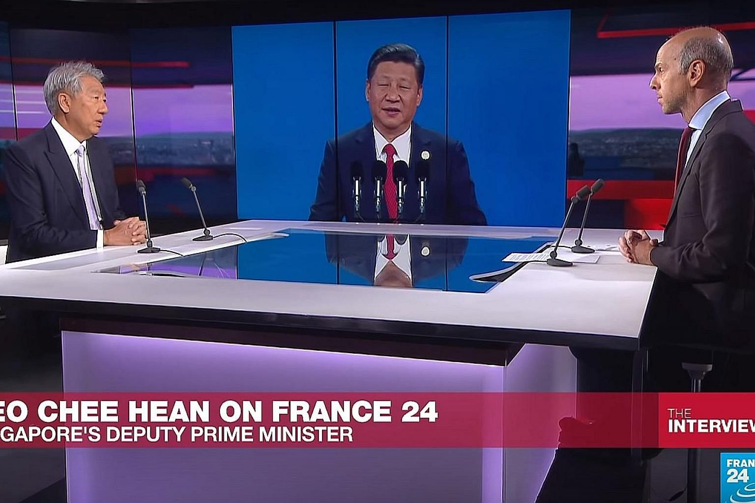 Deputy Prime Minister Teo Chee Hean being interviewed by TV news outlet France 24 on Wednesday. He was asked about the US-China trade row, among other topics.
