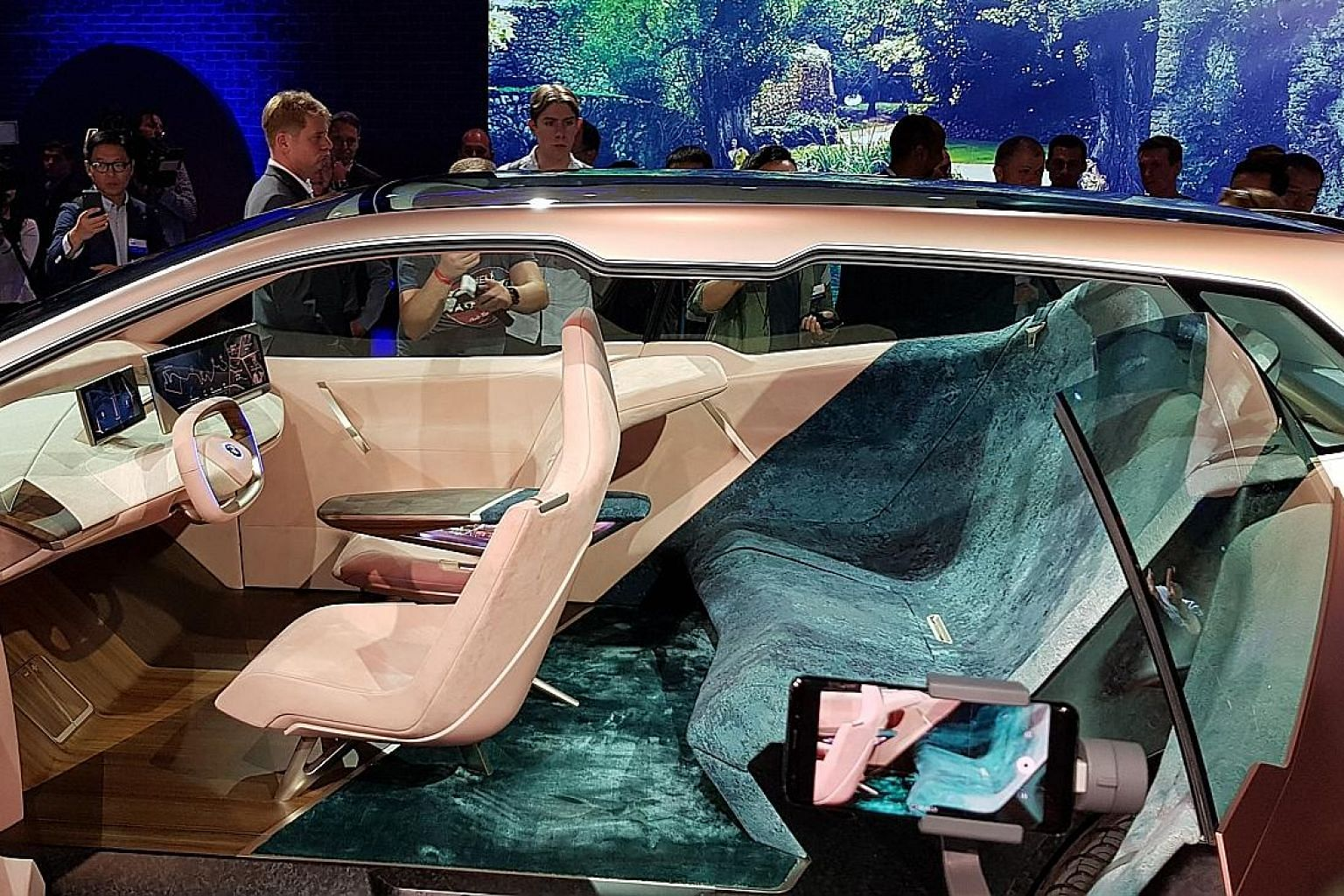 The front seats of the iNext concept car are supported by aluminium legs while the centre armrest resembles Star Trek's Starship Enterprise.