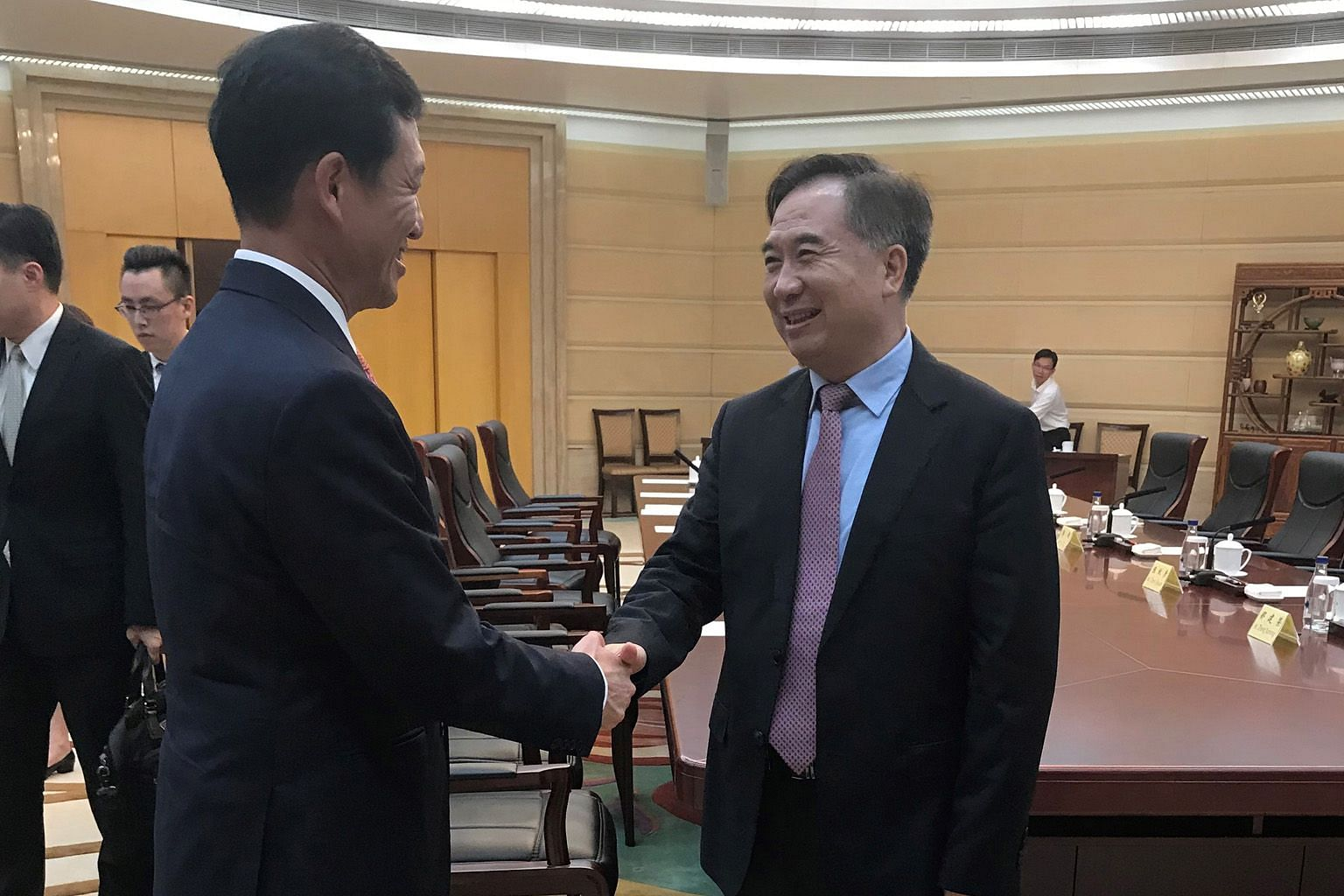 Education Minister Ong Ye Kung (left) calling on Guangdong party boss Li Xi yesterday. Mr Ong is visiting southern Guangdong, where he tested the latest transport links in the Greater Bay Area. The area is positioned as part of a strategic plan for C