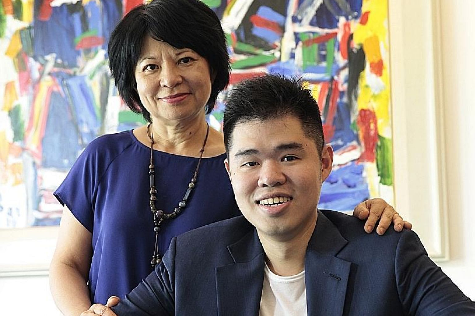Mr Zac Chua, seen here with his mum Lee Li, a 59-year-old retiree, set up The Kettle Gourmet last year to make oven-baked speciality popcorn. He plans to expand with other food products and to markets like Indonesia and Hong Kong.