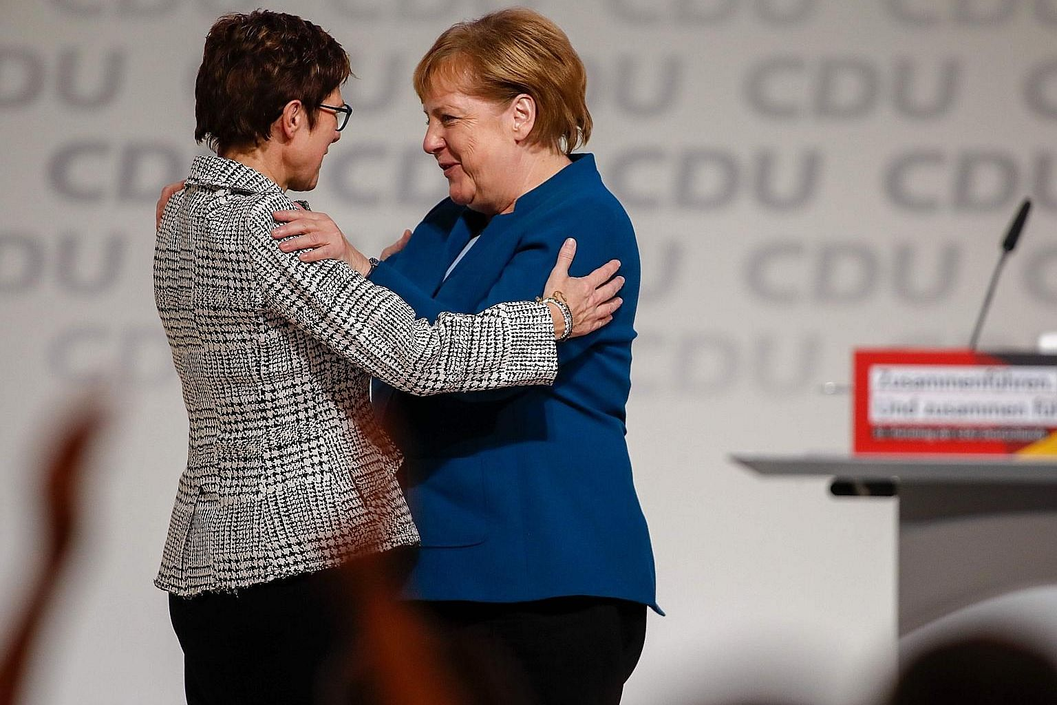 German Chancellor Angela Merkel congratulating her protege, Mrs Annegret Kramp-Karrenbauer, after the latter won a party vote to succeed her as leader of the conservative Christian Democratic Union last Friday. AKK - as she is popularly known by her