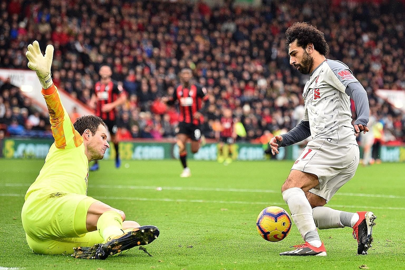 Liverpool forward Mohamed Salah rounding Bournemouth goalkeeper Asmir Begovic before scoring his third goal in the Reds' 4-0 away victory yesterday. The hat-trick took his tally to 10 league goals this season.